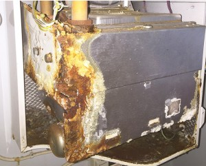 picture of a badly corroded gas boiler
